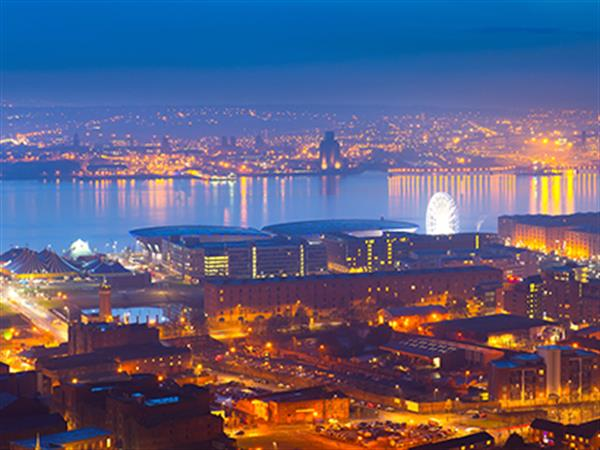 An aerial view of Liverpool at night time with lights shining