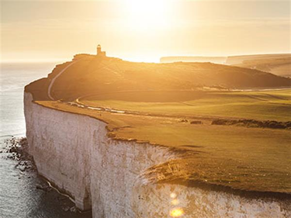 Beautiful image of sun setting over the chalky cliffs in Eastbourne