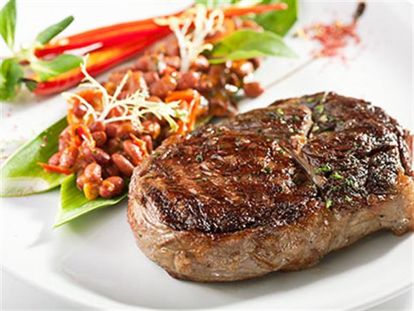 Well cooked steak with healthy sides