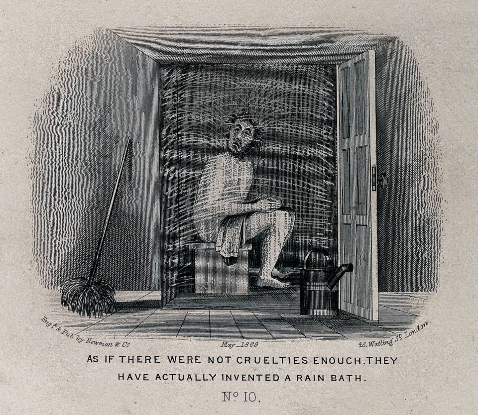 A man seated in a cubicle is being sprayed with water Welcome